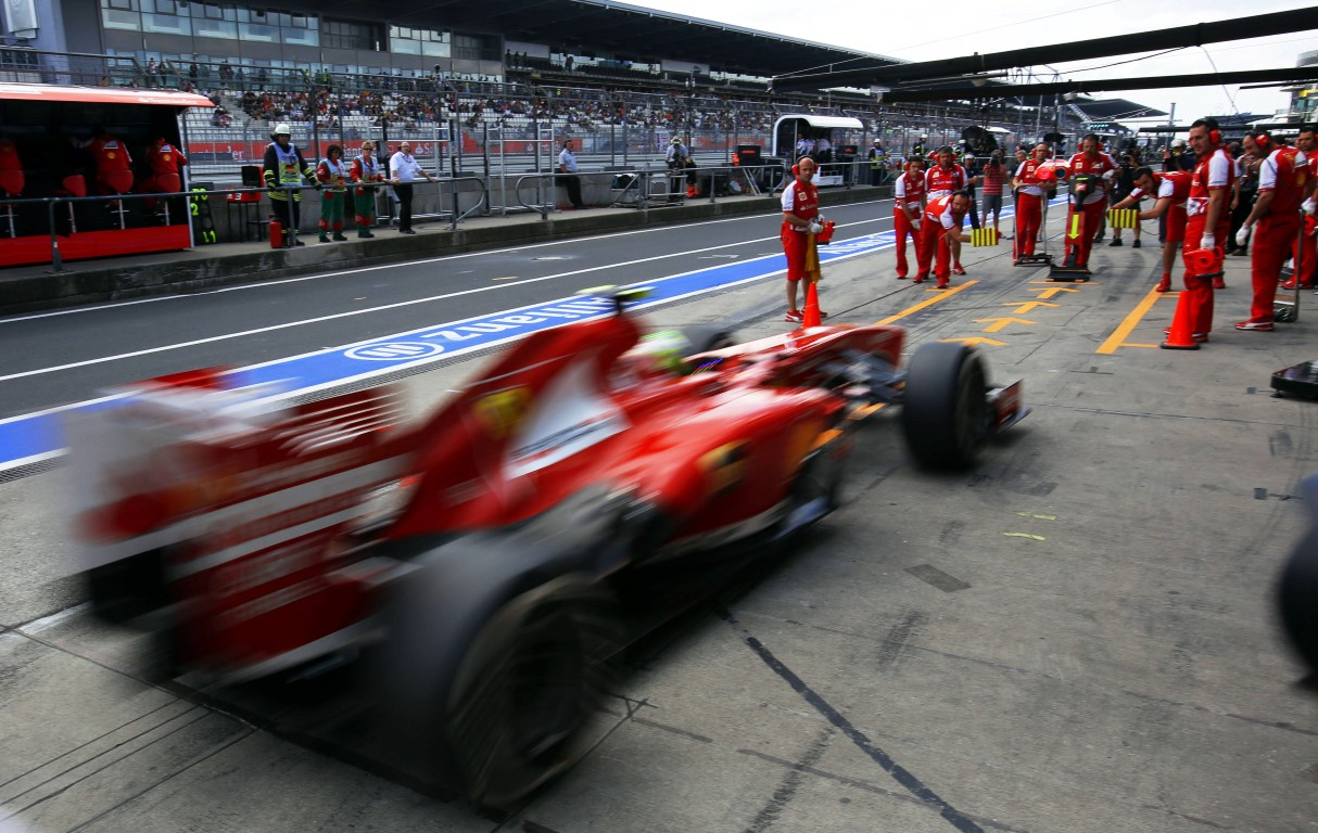 Brazilian Formula One driver Felipe Massa of Ferrari steers his car through the pit lane during the third practice session at the Nuerburgring circuit in Nuerburg, Germany, 06 July 2013. The Formula One Grand Prix of Germany will take place on 07 July 2013. Photo: Jens Buettner/dpa +++(c) dpa - Bildfunk+++ - Infophoto