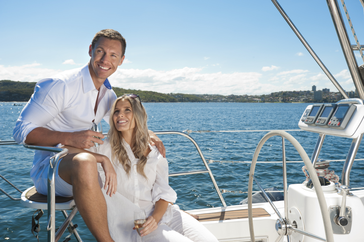 Couple in love sailing on a yacht